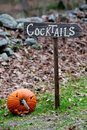 Cocktail sign and jack o lantern Stock Photography