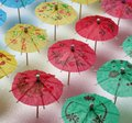 Cocktail umbrella pattern umbrellas of different colors arranged in a Royalty Free Stock Image