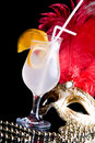 Cocktail and Venetian mask Stock Photography