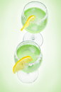 Cocktails green with the lemon Stock Images