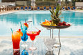 Cocktails sun lounges and by the pool Royalty Free Stock Image
