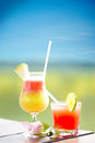 Cocktails on a tropical island glasses with cold fresh drink wooden bar over blurred background Royalty Free Stock Photography