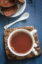 Cocoa drink in a white cup Stock Photos