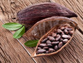 Cocoa pod on a dark wooden table Royalty Free Stock Image