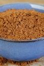 Cocoa powder in bowl blue Stock Photo