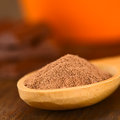 Cocoa powder on wooden spoon very shallow depth of field focus one third into the Stock Photos
