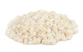 Coconut candied cubes heap on white Royalty Free Stock Photography
