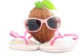 Coconut concept for travel agency with sunglasses and beachwear Royalty Free Stock Photo