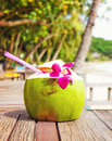 Coconut drink on table beside beach Stock Photo