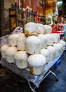 Coconut drinks for sale in vietnam green coconuts full of sweet water at a street food market Royalty Free Stock Image