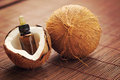 Coconut essential oil bottle of beauty treatment Stock Photos