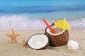 Coconut fruit cocktail drink in summer on the beach and sea Royalty Free Stock Photo