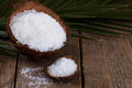 Coconut grounded flakes close up of a on natural wooden background Stock Image