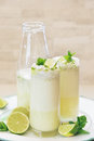 Coconut Lime Beverage in glasses and bottle Royalty Free Stock Photo