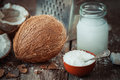 Coconut milk, grounded coconut flakes, coco nut and grater Royalty Free Stock Photo