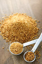Coconut palm sugar in measuring spoons Royalty Free Stock Photo