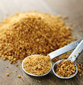 Coconut palm sugar in measuring spoons organic Stock Images