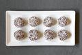 Coconut rum balls on plate photographed overhead on slate with natural light selective focus focus on the top of the Stock Photos