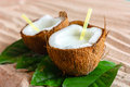 Coconut on the sand beach broken into pieces Stock Photo
