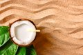 Coconut on the sand beach broken into pieces Royalty Free Stock Images