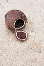 Coconut shell on the beach close up Royalty Free Stock Images
