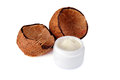 Coconut shells and  jar of cream Royalty Free Stock Photos