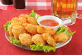 Coconut shrimp and beer Royalty Free Stock Images
