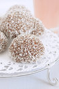 Coconut snowballs a marshmallow confection covered in chocolate and dessicated Stock Photo