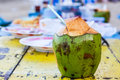 Coconut water drink on table at beach Stock Photos