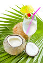 Coconut water in glass served on palm leaf Stock Photo