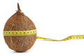 Coconut with yellow measuring tape the concept of diet and health Royalty Free Stock Photo