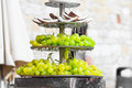 Coconuts and grapes cooling stand a coconut with fresh water Stock Image
