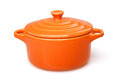 Cocote orange casserole dish or crock pot isolated on white Royalty Free Stock Photos