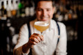 Coctail in barmans hand Royalty Free Stock Photo