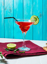 Coctail margarita with lime on blue wood background Royalty Free Stock Photo