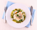 Cod fillet with green beans peas parsley olive oil top view Stock Images