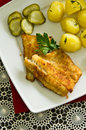 Cod fish fillet with potatoes dinner dish of Stock Image