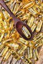 Cod liver oil capsules close up of Royalty Free Stock Photos