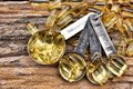 Cod liver oil capsules close up of Royalty Free Stock Images