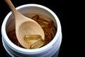 Cod liver oil capsules close up of Stock Photos