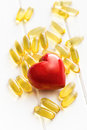 Cod liver oil gel capsules with red heart Stock Photo