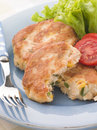 Cod and Salmon Fish Cakes with Corn and Salad Royalty Free Stock Photos