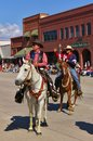 Cody, Wyoming, USA - July 4th, 2009 - Two riders greet the spectators while riding with the Independence Day Parade Royalty Free Stock Photo