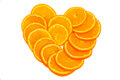 Coeur orange de fruit sur un fond blanc Photos stock