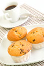 Cofee and chocolate chip muffins Stock Images