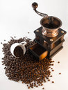 Coffe beans grinder and cup Royalty Free Stock Photos
