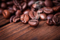 Coffe beans on the woden table Royalty Free Stock Photos