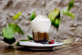 Coffe with cream and box of chocolate stay on the wood table and falling leaf on background Stock Photography