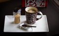 Coffe cup and brown sugar on white plate Stock Image