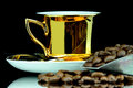 Coffe cup isolated old gold and beans Royalty Free Stock Image